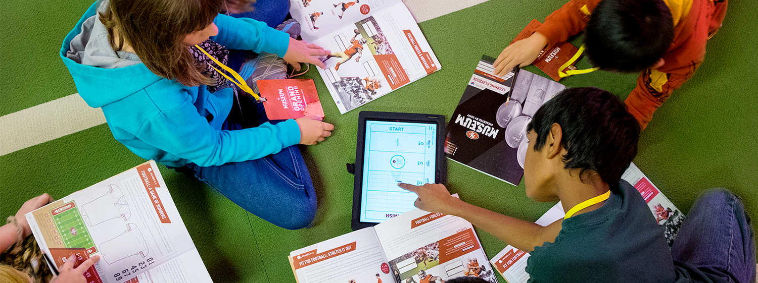 Children on Floor with 49ers Museum Playbook 2016