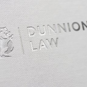 Dunnion Law Embossed Logo