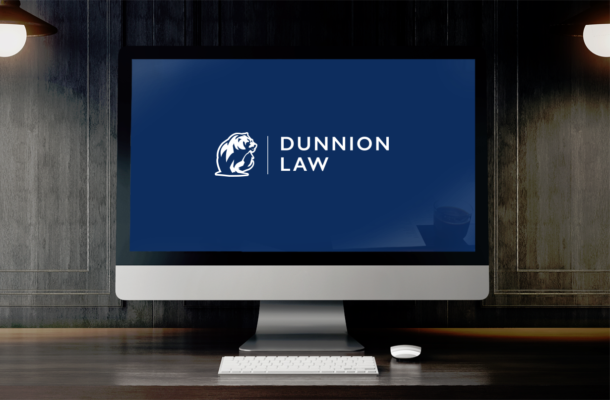 Dunnion Law Logo on Desktop Computer