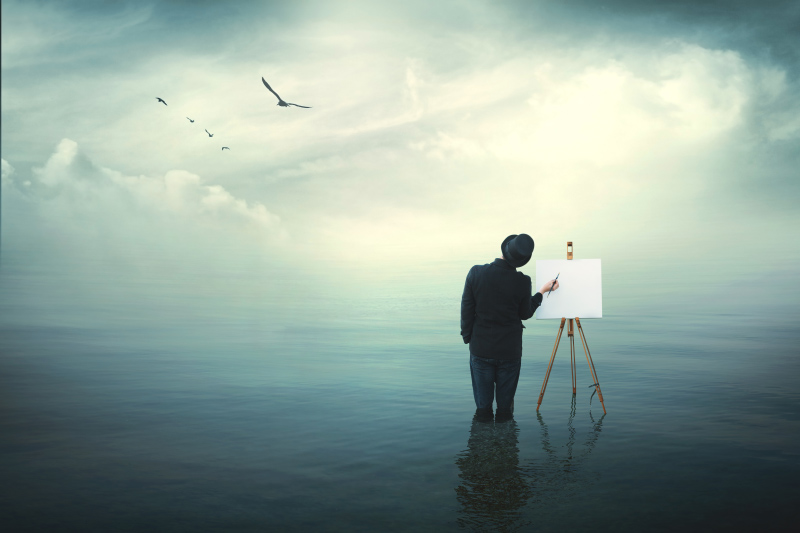 Surreal painter standing in water painting a cloudy sky