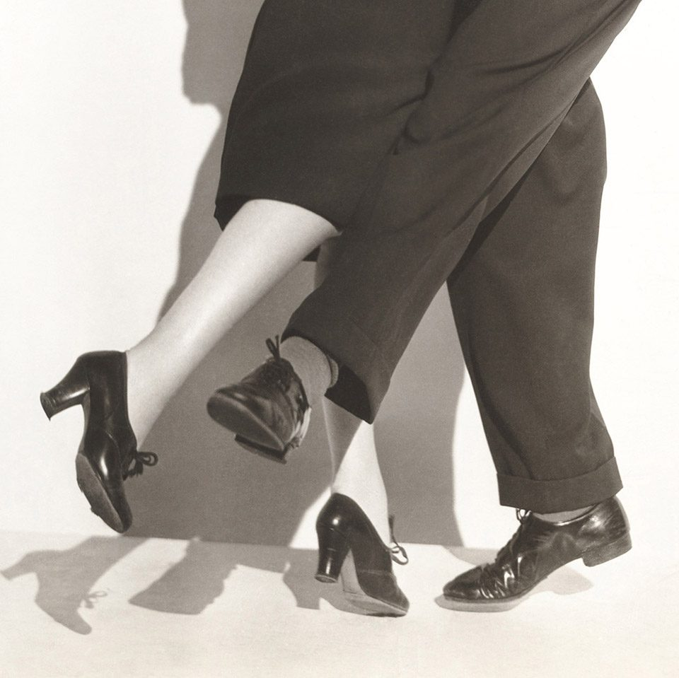 Two dancers toe to toe